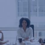 Woman sits at executive table