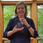Rosalind Picard holding MEDx Distinguished Lecture award