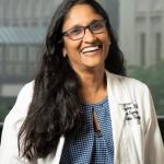 Shyni Varghese in lab coat